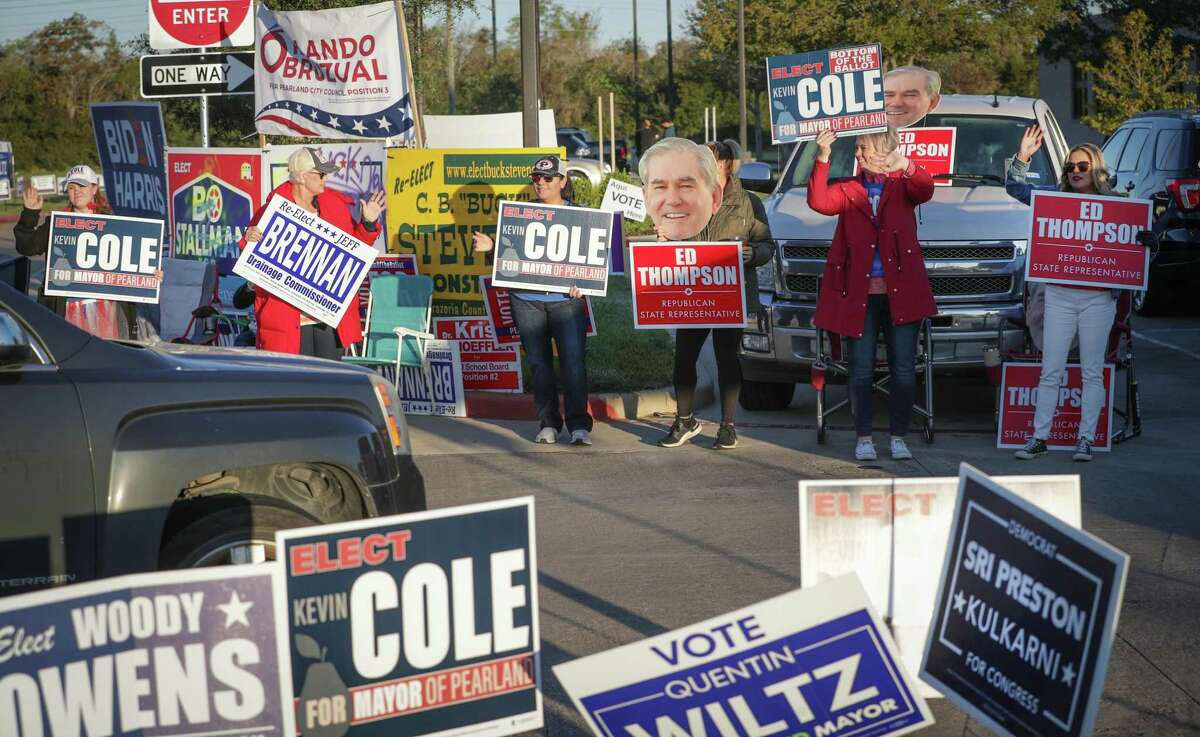 Voters were greeted by campaign workers as the arrived to vote at the Tom Reid Library Tuesday, Nov. 3, 2020, in Pearland.