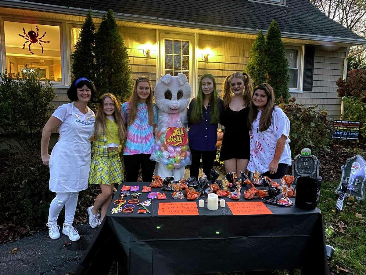 Trumbull residents Kathleen Hoefer, Addison Hoefer, Lauren Clark, Julia Grillo, Finley Gray, Sienna Hoefer and Sophia Falco wait for trick-or-treaters outside.