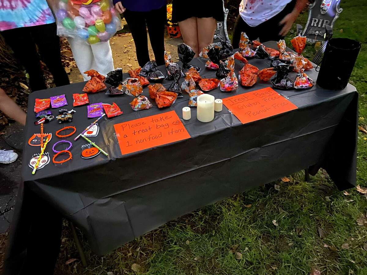 Self-serve table of Halloween treats.