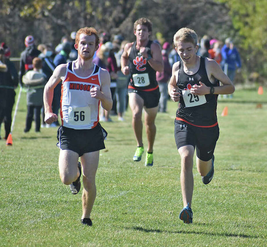 Edwardsville's Jacob Grandone, right, sprints to the finish line against Minooka's Jake Manning during the Class 3A Normal Community Sectional.