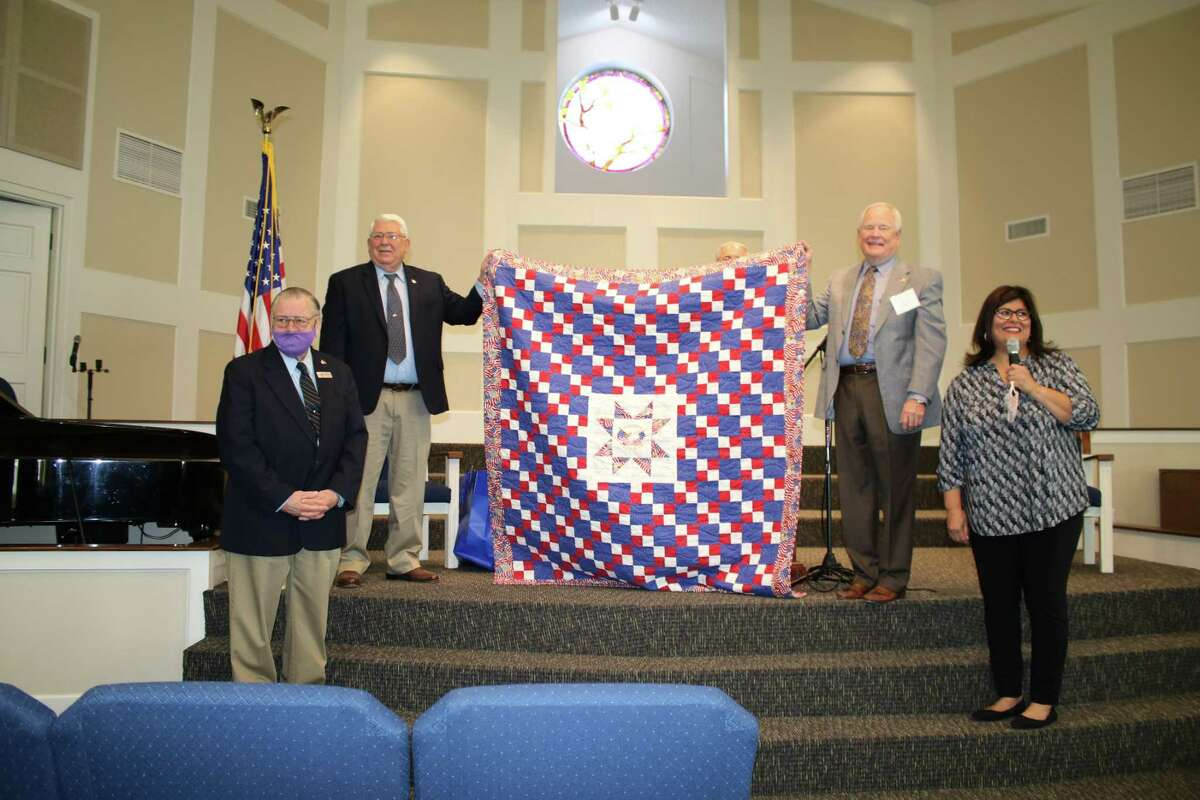 Thomas Light, far left, was presented a specially made quilt from the Golden Needles Quilt Guild on Nov. 1 at West Conroe Baptist Church. The guild presents handmade quilts to veterans each November to recognized their service. Pictured from left are Light, Jerry Smith, Cecil Jones and guild member Mary Olivarez.