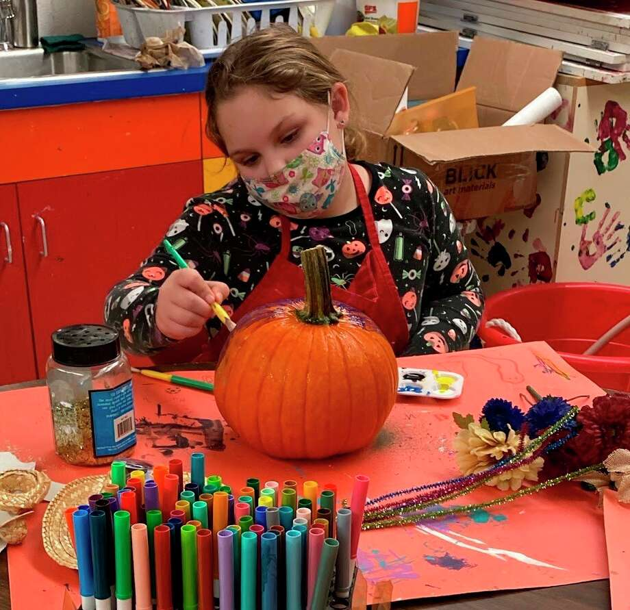Olivert Baumann is painting her pumpkin during Session 1. (Photo Provided)