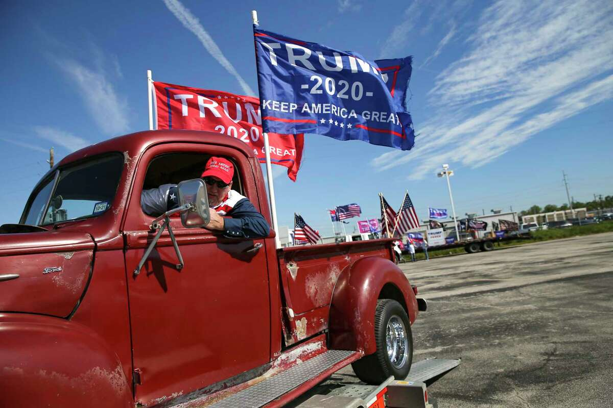 Mike Howell of Coolidge, Texas puts his 1942 Ford F-1 truck back on a trailer after participating in a Trump support rally drive around the 610 loop in Houston on Sunday, Nov. 1, 2020. (Elizabeth Conley/Houston Chronicle via AP)