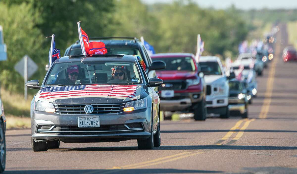 Supporters of President Donald Trump drive down Espejo Molina Road, Saturday, Oct. 31, 2020, as they exit El Cenizo on their way through South Laredo.