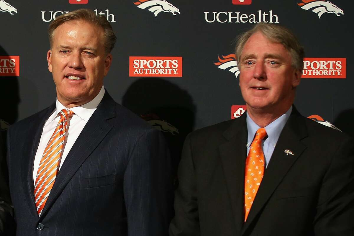 Broncos general manager John Elway (left) and team president Joe Ellis both received positive COVID-19 tests. Tuesday.