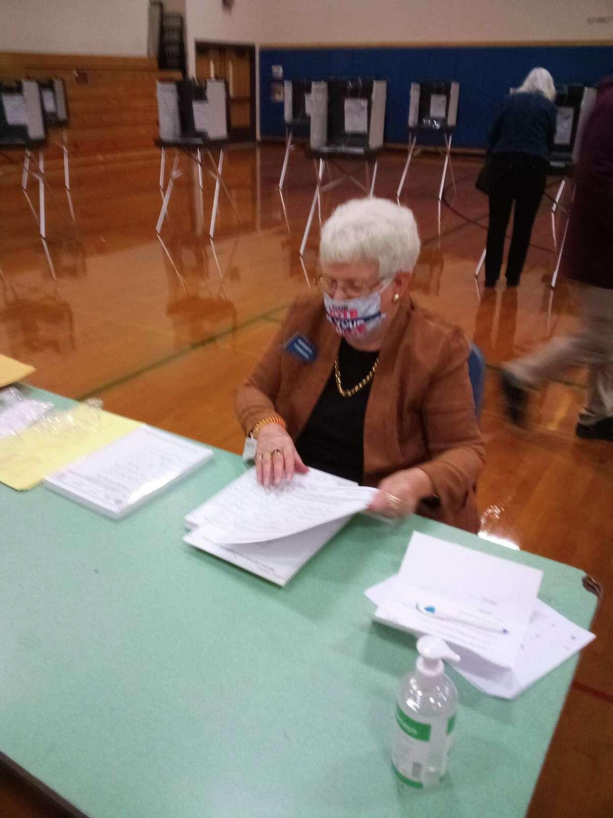 Eleanor Fox, election moderator, at Torrington Middle School Tuesday, Nov. 3, 2020.