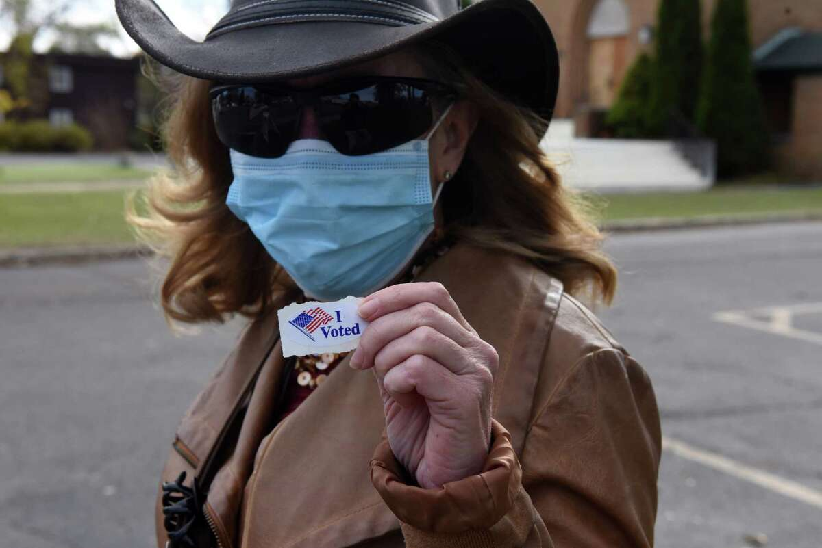 """Julia Lecomte, of Colonie displays her """"I Voted"""" sticker after voting in the general election at the Pine Grove United Methodist Church polling station on Tuesday, Nov. 3, 2020, on Central Avenue in Colonie, N.Y. (Will Waldron/Times Union)"""
