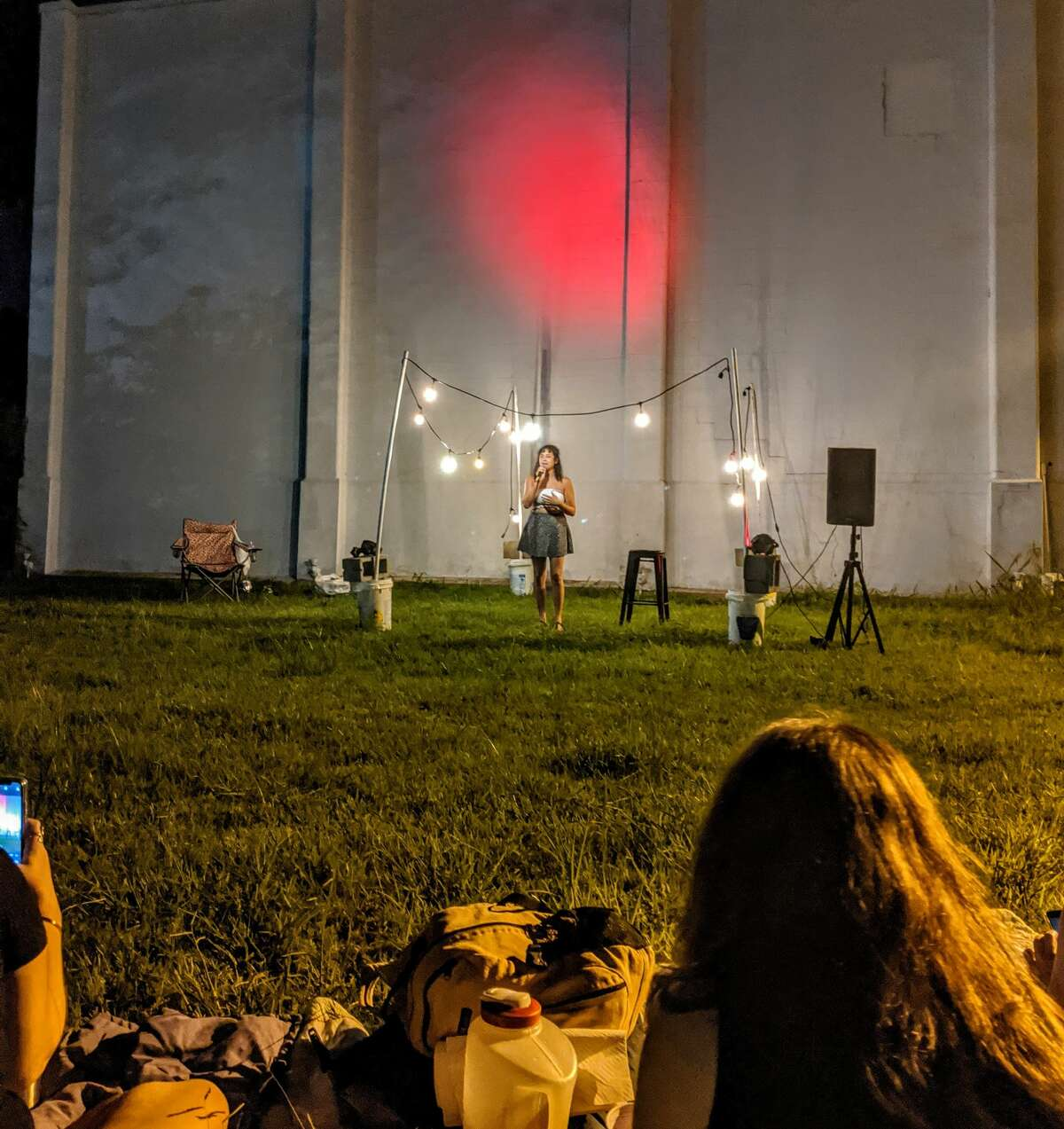 Audiences enjoy standup comedy in a comedy garden organized by 5th Wave Productions to allow safe, in-person entertainment amid the pandemic.