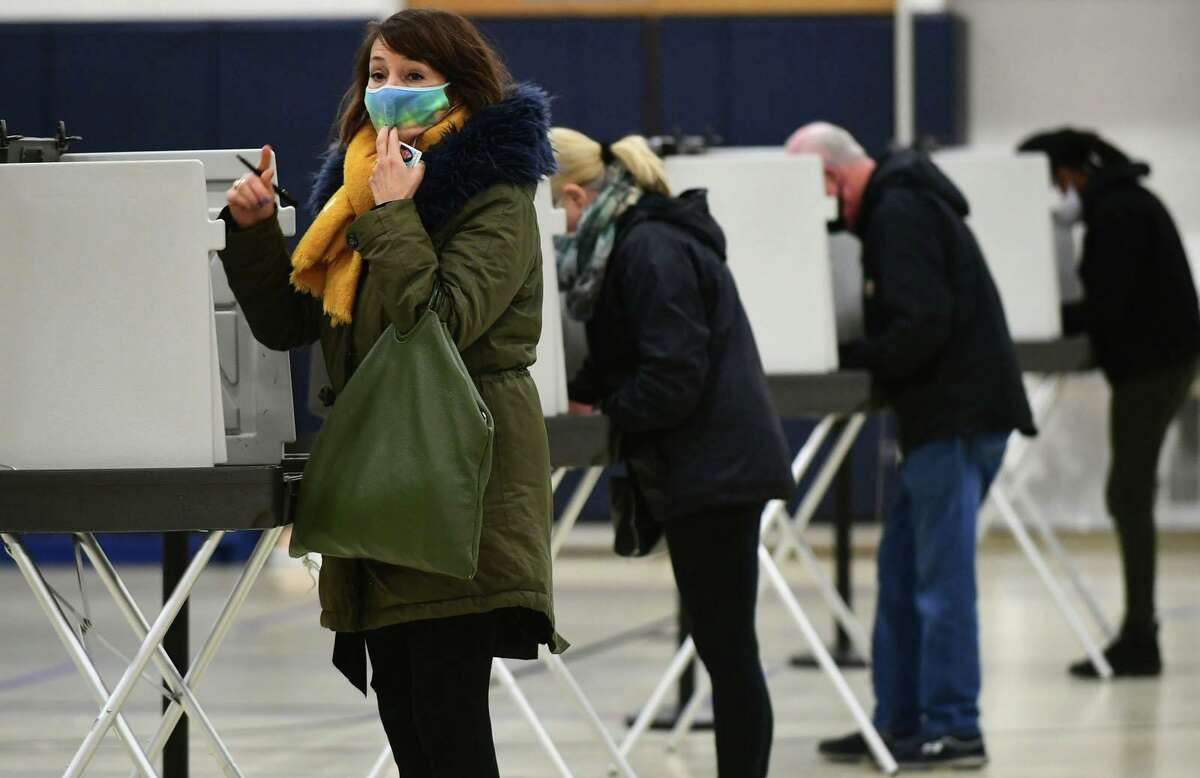 Wilton resident Martha Barrerro casts her vote at Cider Mill Elementary School Tuesday, November 2, 2020.
