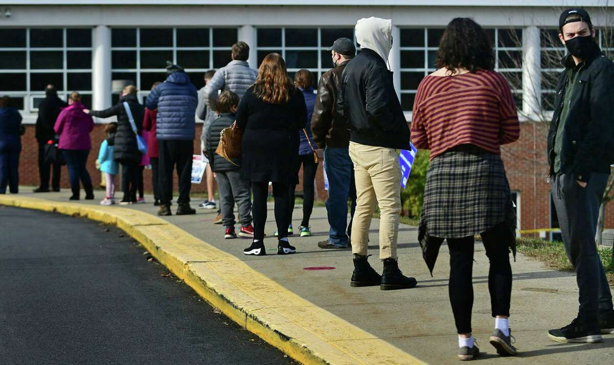 Wilton residents line up to vote at Cider Mill Elementary School Tuesday, November 2.