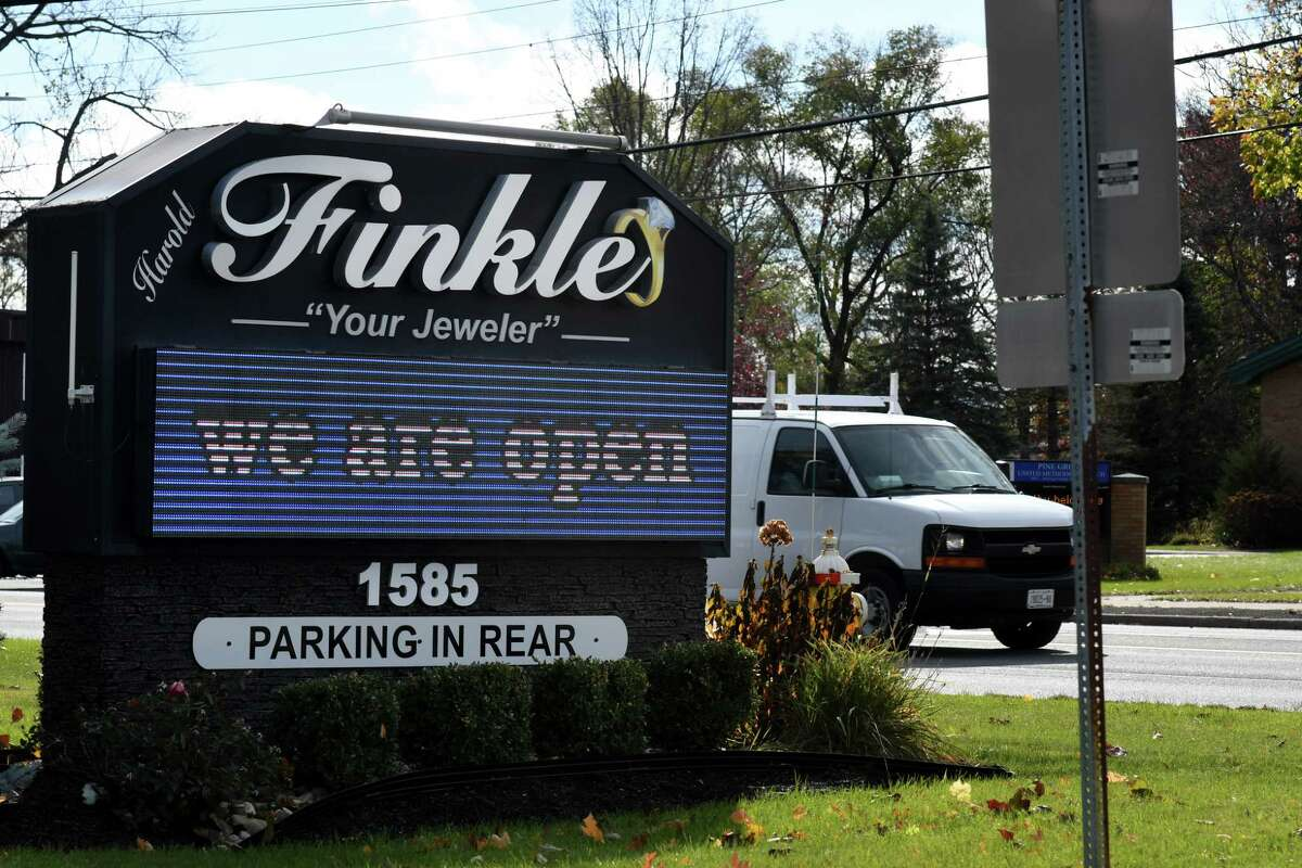 A digital sign is used outside the Harold Finkle Your Jeweler store on Tuesday, Nov. 3, 2020, on Central Avenue in Colonie, N.Y. Guilderland has temporarily banned digital signs. They are approved for use in Colonie. (Will Waldron/Times Union)