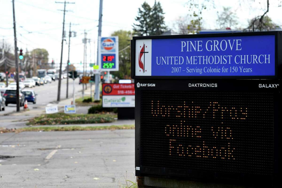 A digital sign is used outside at the Pine Grove United Methodist Church on Tuesday, Nov. 3, 2020, on Central Avenue in Colonie, N.Y. Guilderland has temporarily banned digital signs. They are approved for use in Colonie. (Will Waldron/Times Union)