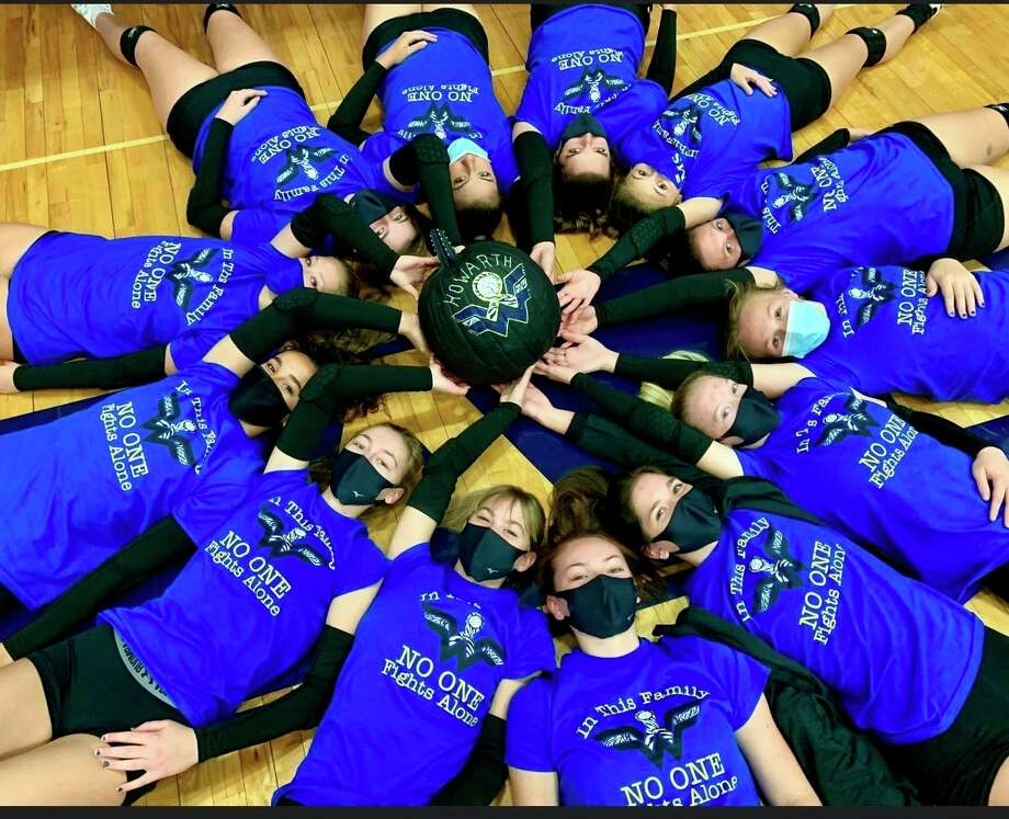 The Morley Stanwood volleyball team poses in their Whipple Warrior t-shirts. Students with the volleyball team raised $2,500 for sixth-grade teacher Michelle Howarth. (Courtesy photo)