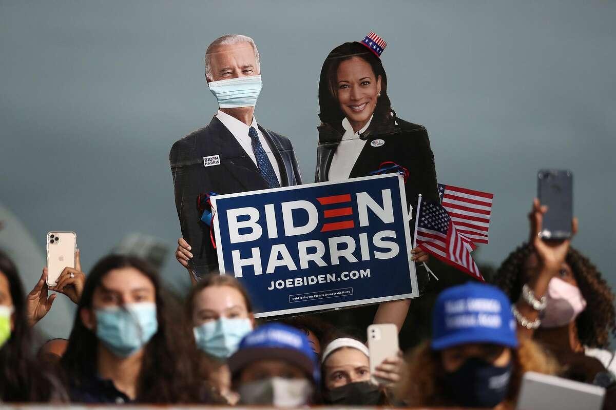 Cardboard cutouts of Democratic presidential nominee Joe Biden and vice presidential nominee Kamala Harris at a Miami rally Monday.