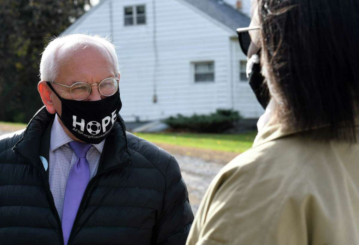 U.S. Rep. Paul Tonko, left, speaks to 49th State Senate district Democratic candidate Thearse McCalmon, right, after picking up lunch from the Malta Ridge United Methodist Church on Tuesday, Nov. 3, 2020, in Ballston Spa, N.Y. Tonko is challenge for the 20th Congressional District seat by Republican candidate Elizabeth Joy. McCalmon is running against Sen. James Tedisco. (Will Waldron/Times Union)