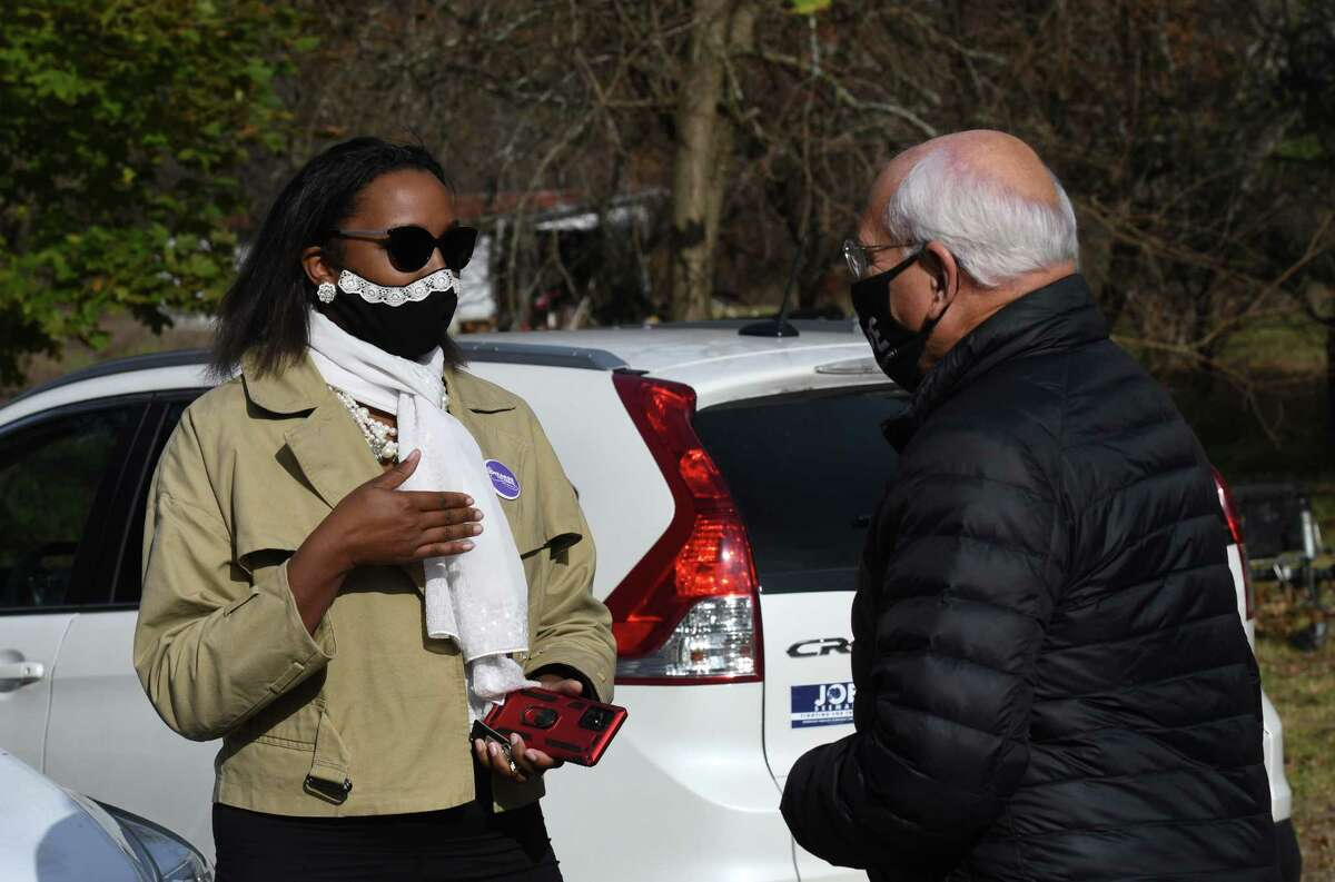 Thearse McCalmon, 49th State Senate district Democratic candidate, left, speaks to U.S. Rep. Paul Tonko, right, after picking up lunch from the Malta Ridge United Methodist Church on Tuesday, Nov. 3, 2020, in Ballston Spa, N.Y. Tonko is challenge for the 20th Congressional District seat by Republican candidate Elizabeth Joy. McCalmon is running against Sen. James Tedisco. (Will Waldron/Times Union)