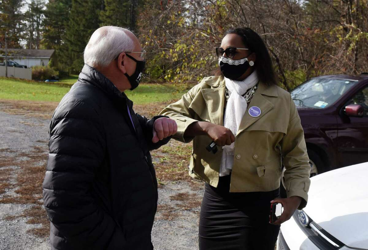 U.S. Rep. Paul Tonko, left, greets 49th State Senate district Democratic candidate Thearse McCalmon, right, after picking up lunch from the Malta Ridge United Methodist Church on Tuesday, Nov. 3, 2020, in Ballston Spa, N.Y. Tonko is challenge for the 20th Congressional District seat by Republican candidate Elizabeth Joy. McCalmon is running against Sen. James Tedisco. (Will Waldron/Times Union)