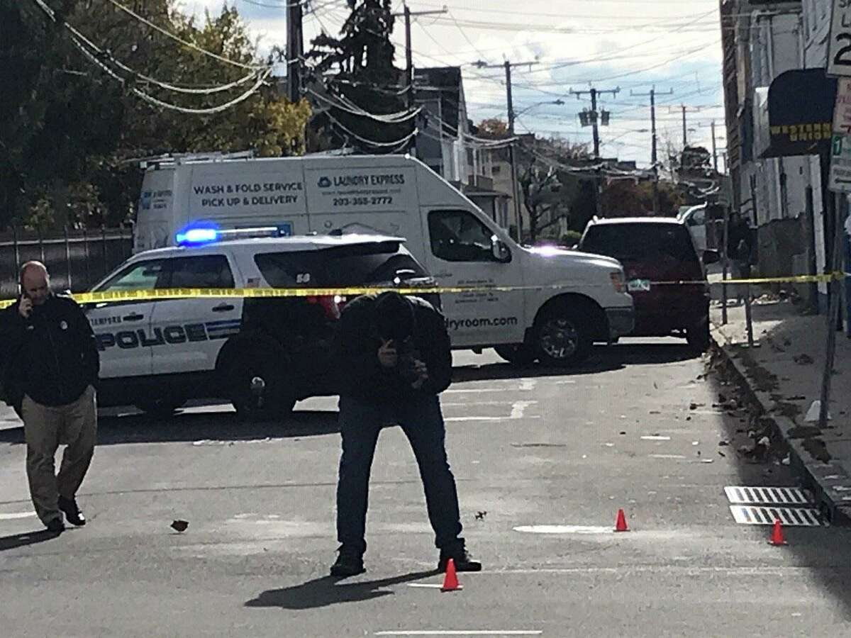 Crime scene investigators document and collect four shell casings at a noon shooting, where one man fired on another at the corner of Stillwater Avenue and Virgil Street in Stamford on Tuesday, Nov. 3. No one was injured.