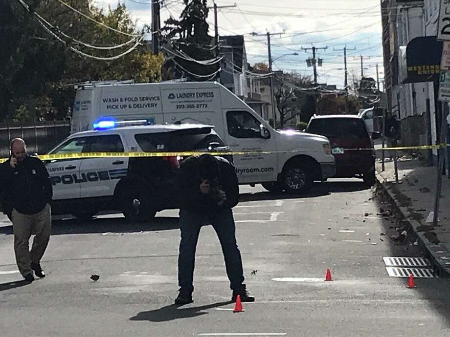 Crime scene investigators document and collect four shell casings at a noon shooting, where one man fired on another at the corner of Stillwater Avenue and Virgil Street in Stamford on Tuesday, Nov. 3. No one was injured. Photo: John Nickerson / Hearst Media Connecticut