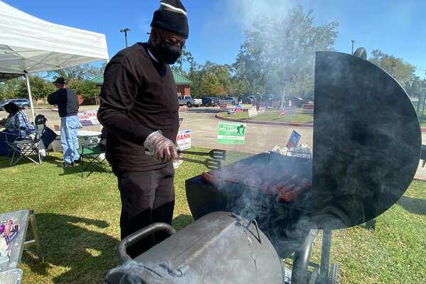 Robert George mans the grill to serve up food for voters at the Davis Community Center.