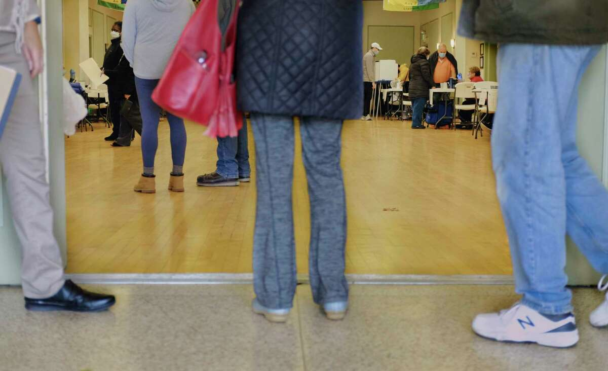 Voters line up to cast their ballots at the Ancient Order of Hibernians on Election Day, Tuesday, Nov. 3, 2020, in Albany, N.Y. (Paul Buckowski/Times Union)