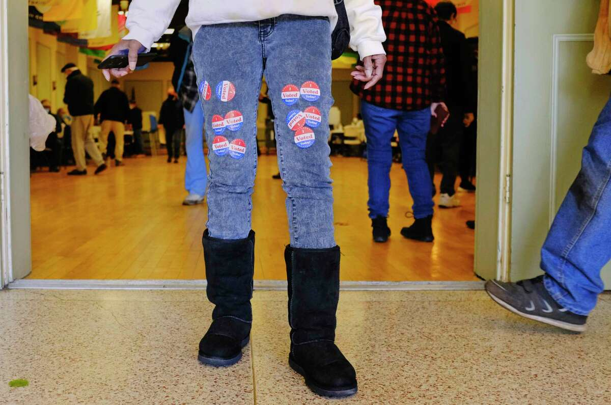Poll worker Valerie Hammond decorated her pants with I voted stickers as she worked at the Ancient Order of Hibernians on Election Day, Tuesday, Nov. 3, 2020, in Albany, N.Y. Hammond has worked the polls for the past seven years. (Paul Buckowski/Times Union)