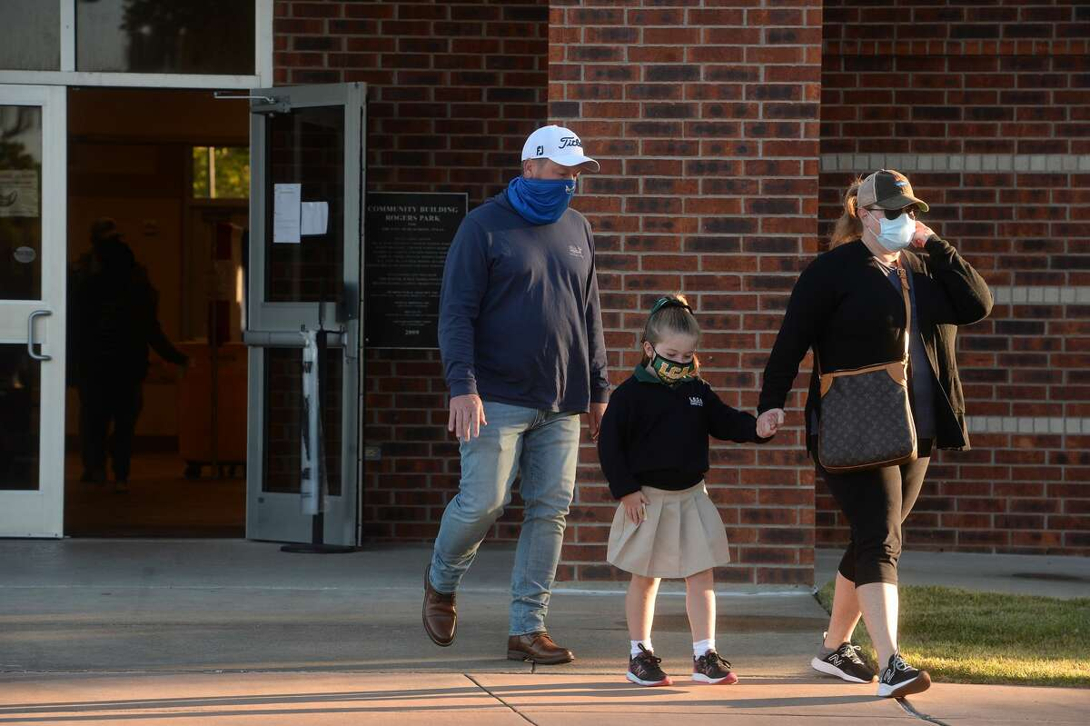 A family leaves the Rogers Park polling site after arriving to vote shortly after doors opened Tuesday. By 7:10 a.m., the line waiting fofr the poll to open had diminished quickly, and voters arriving after doors opened were met with little to no wait time to cast their ballots. Photo taken Tuesday, November 3, 2020 Kim Brent/The Enterprise