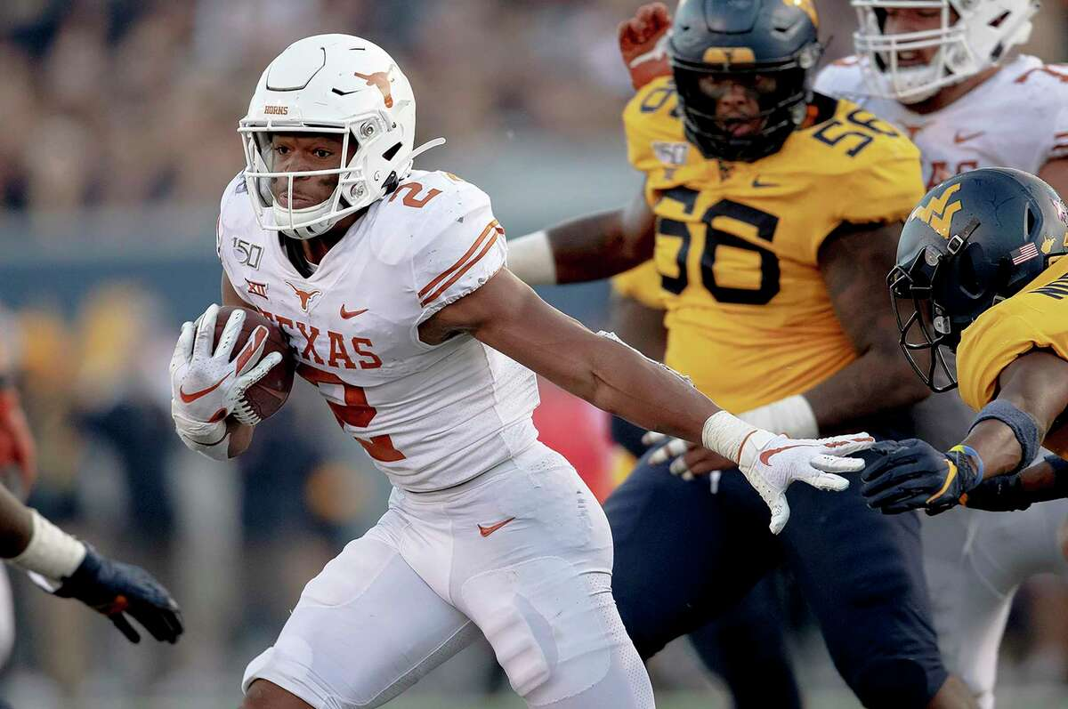 Running back Roschon Johnson and the Longhorns host West Virginia at 11 a.m. Saturday.
