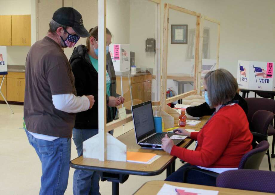 Election volunteers were busy Tuesday as they spent the day helping registered voters submit their tickets. (Pioneer photo/Taylor Fussman)