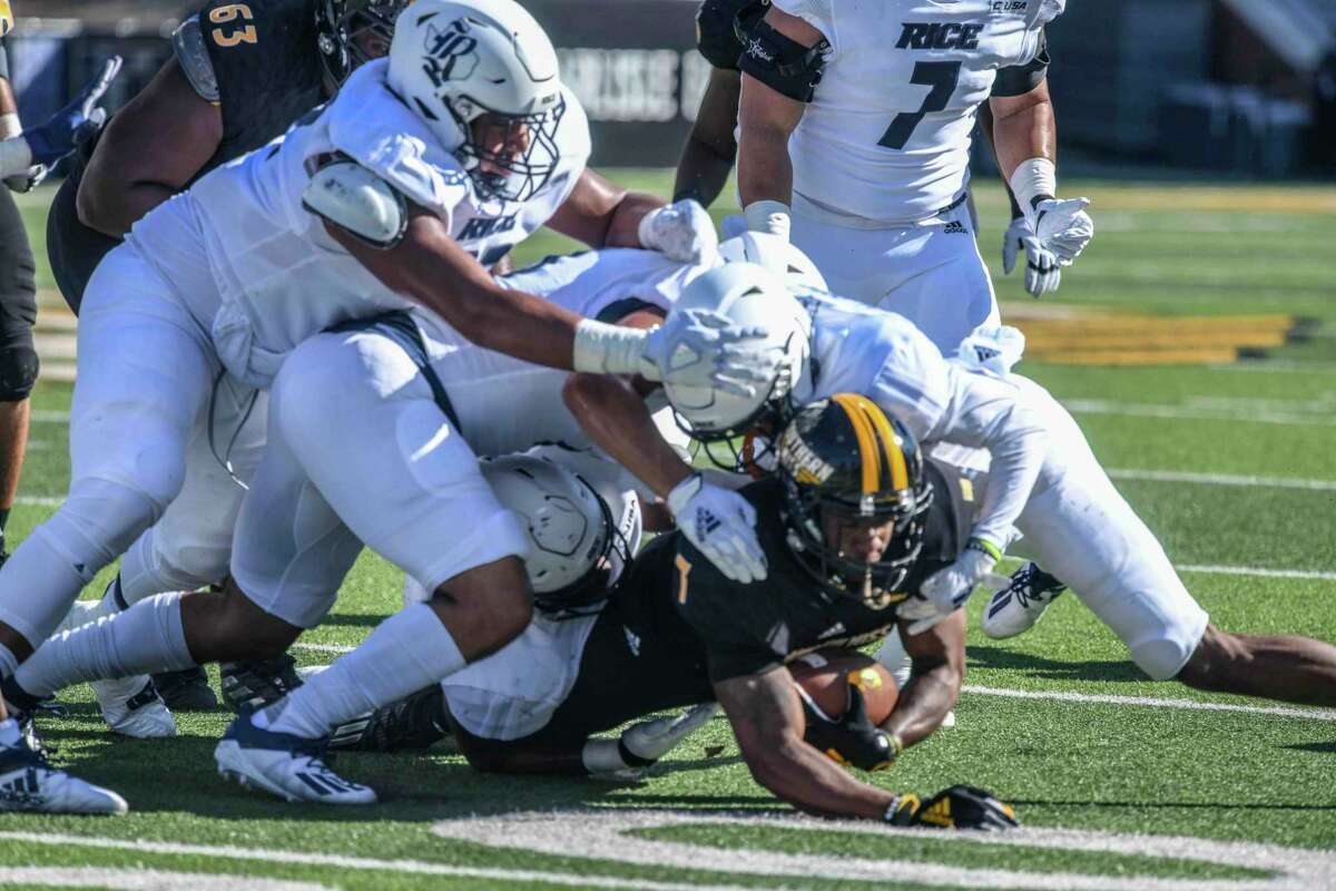 A swarm of Rice defenders stymies Southern Miss running back Darius Mayberry during the Owls' 30-6 road victory last Saturday.
