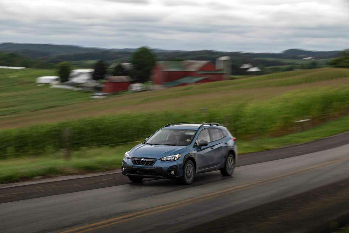 The 2021 Crosstrek Sport features an impressive 8.7-inch ground clearance, a 182-horsepower boxer engine and water-repellant imitation leather upholstery.