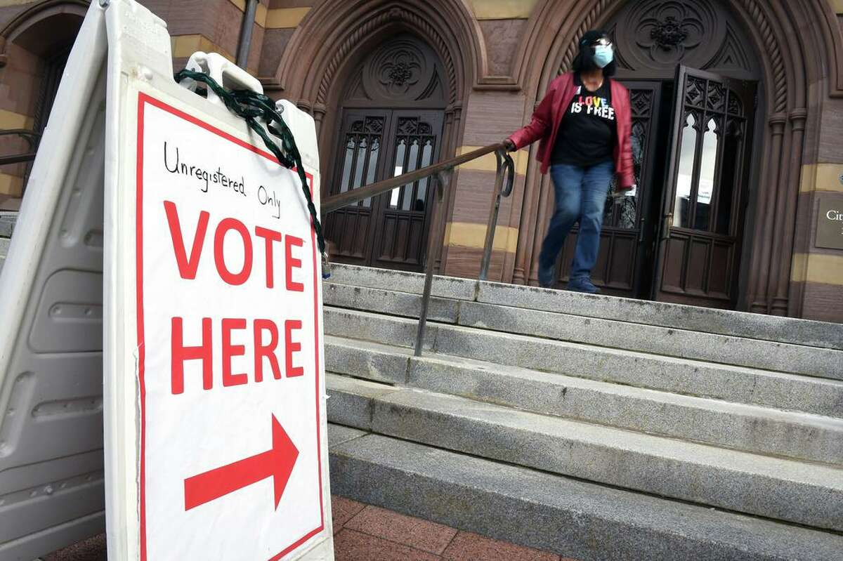 A woman walks out of City Hall in New Haven on November 3, 2020 which was the central location in New Haven for same day registration and voting on election day.