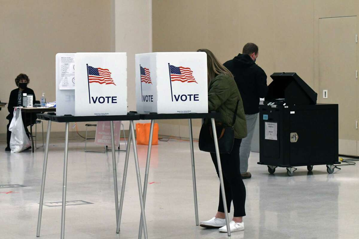 Voters cast their ballots at the Saratoga Springs City Center polling station on Tuesday, Nov. 3, 2020, on Broadway in Saratoga Springs, N.Y. (Will Waldron/Times Union)