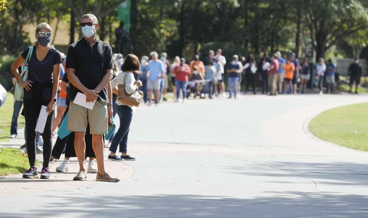Line at the South Montgomery County Community Center on the first day of Early Voting, Tuesday, Oct. 13, 2020, in The Woodlands.