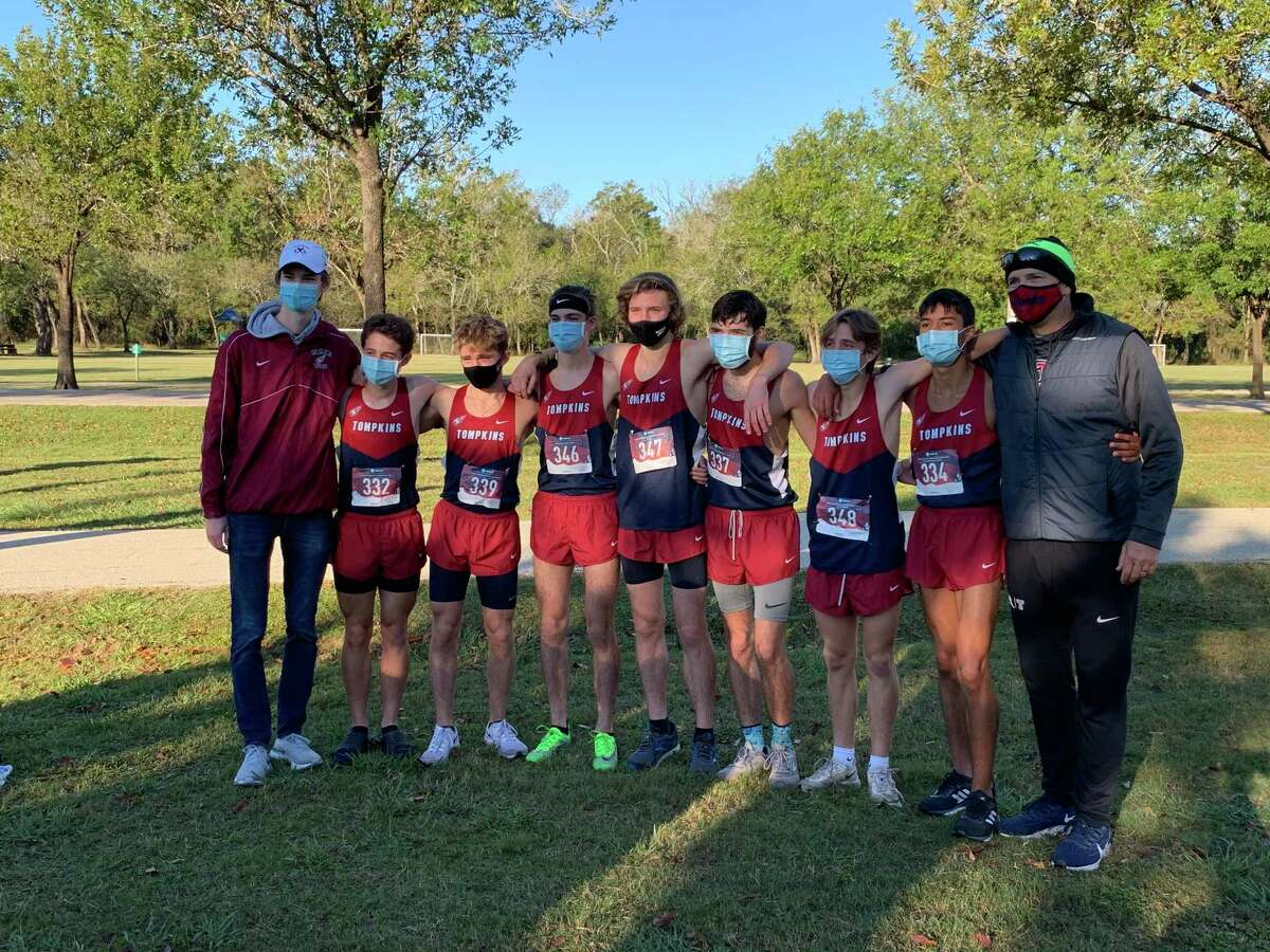 The Tompkins boys cross country team of Gavin Saacke, Ben Smith, Noah Howard, Connor Augustine, Omar El Miloudi, Colton Howard and Jackson Torti won its fourth District 19-6A championship in five years Oct. 30 at Bear Creek Park.