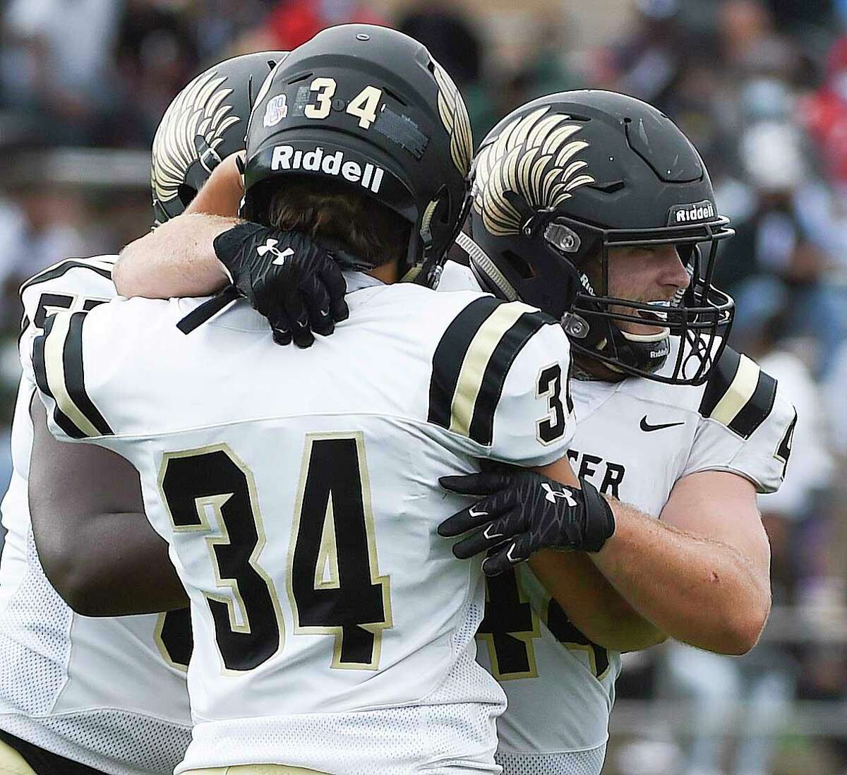 Foster running back Blayne Ciancone, right, celebrates his go-ahead and eventual game-winning touchdown with Christian Tomasino (34) during the second half of a high school football game against Hightower, Saturday, Oct. 24, 2020, in Sugar Land, TX.