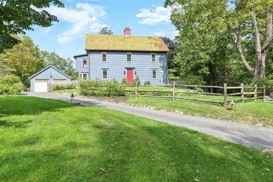 The slate blue updated antique colonial house at 46 Kings Highway South is one of the oldest houses built in Westport in 1700, but has modern amenities for today's lifestyle. Photo: Contributed Photo /