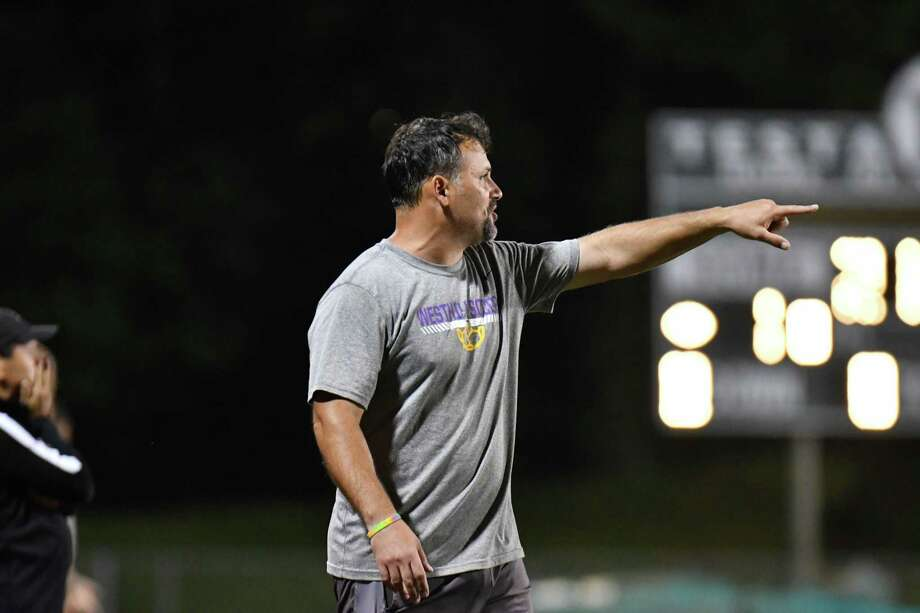 Head Coach Joe Andrews of Westhill Vikings works from the sideline during a match against the Norwalk Bears on Monday Sept 17, 2018, on Testa Field at Norwalk High School in Norwalk, Connecticut. Photo: Gregory Vasil / For Hearst Connecticut Media / Connecticut Post Freelance