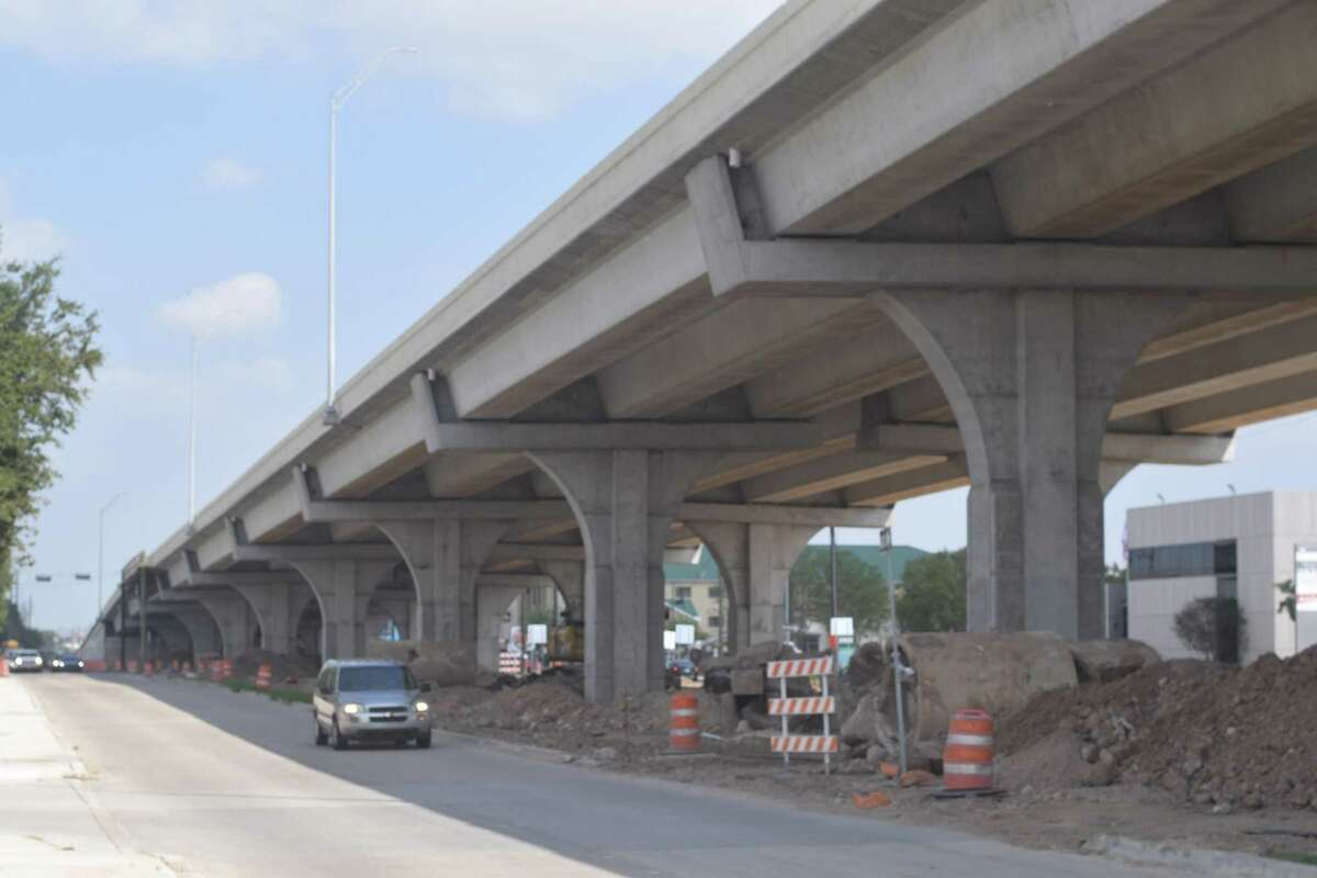 Construction crews are working on paving, signage, a raised center median and storm sewer installation on the under-construction FM 1960/Hwy. 6 bridge over U.S. 290.
