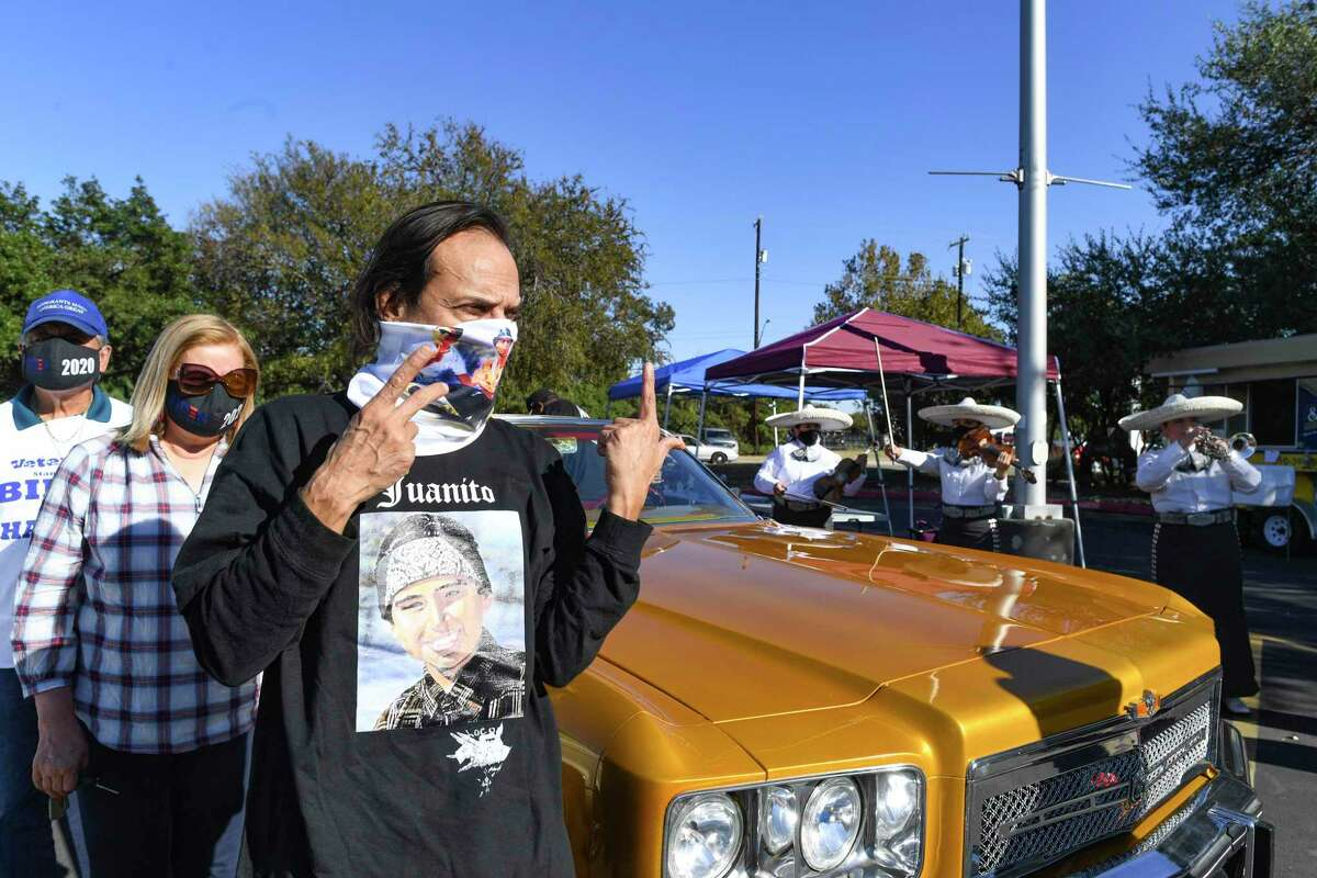 Actor Jesse Borrego gestures after riding in a procession that included low rider cars through West and East San Antonio to encourage people to vote on Election Day. The ride ended at the AT&T Center, where they were treated to a mariachi performance.