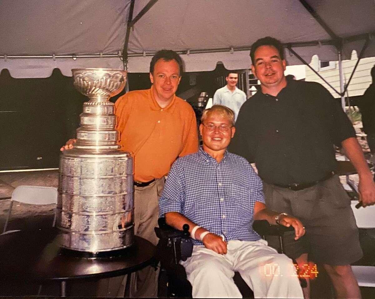 Michael Ferguson, left, with Travis Roy and John Ferguson.