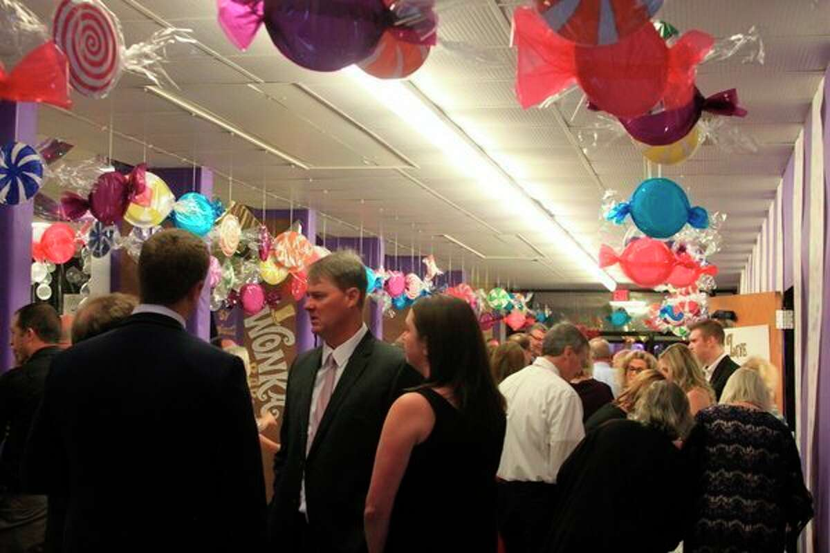Patrons mingle among the elaborately decorated hallways of Manistee Catholic Central duringthe 2019 HARVEST Fling. Due to the coronavirus pandemic, this year's fundraiser will feature to-go dinners, an online auction and raffles. (File photo)