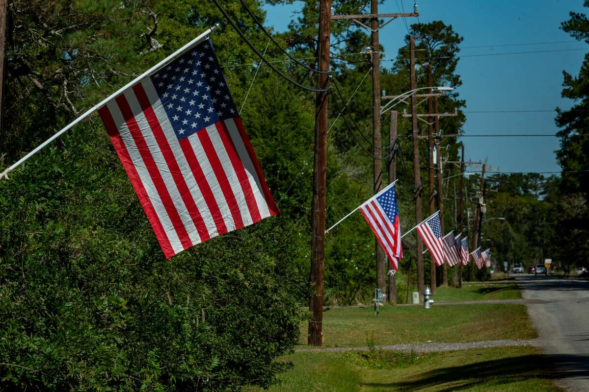 Bevil Oaks welcomes folks with a line of American flags lining Sweetgum Road, the main road into town. Photo made on November 3, 2020. Fran Ruchalski/The Enterprise