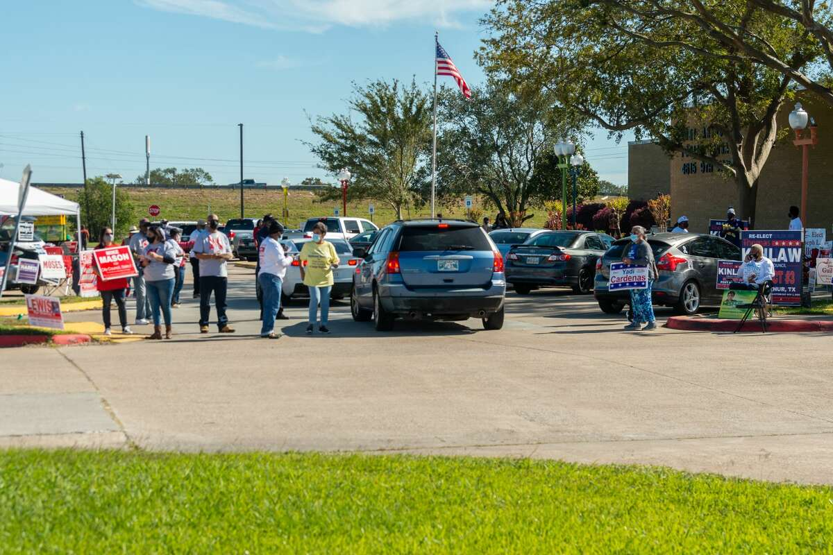 Candidate supporters greet voters as they come to vote at the Port Arthur Public Library on election day. Photo made on November 3, 2020. Fran Ruchalski/The Enterprise