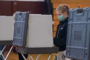 Katie Czyr, of Bethel, votes at Bethel's Municipal Center on Election Day, Nov. 3, 2020. The Municipal Center was one of three polling locations open during Bethel's referendum vote April 20, 2021, on the town's proposed $81.9 million spending plan for 2021-22.