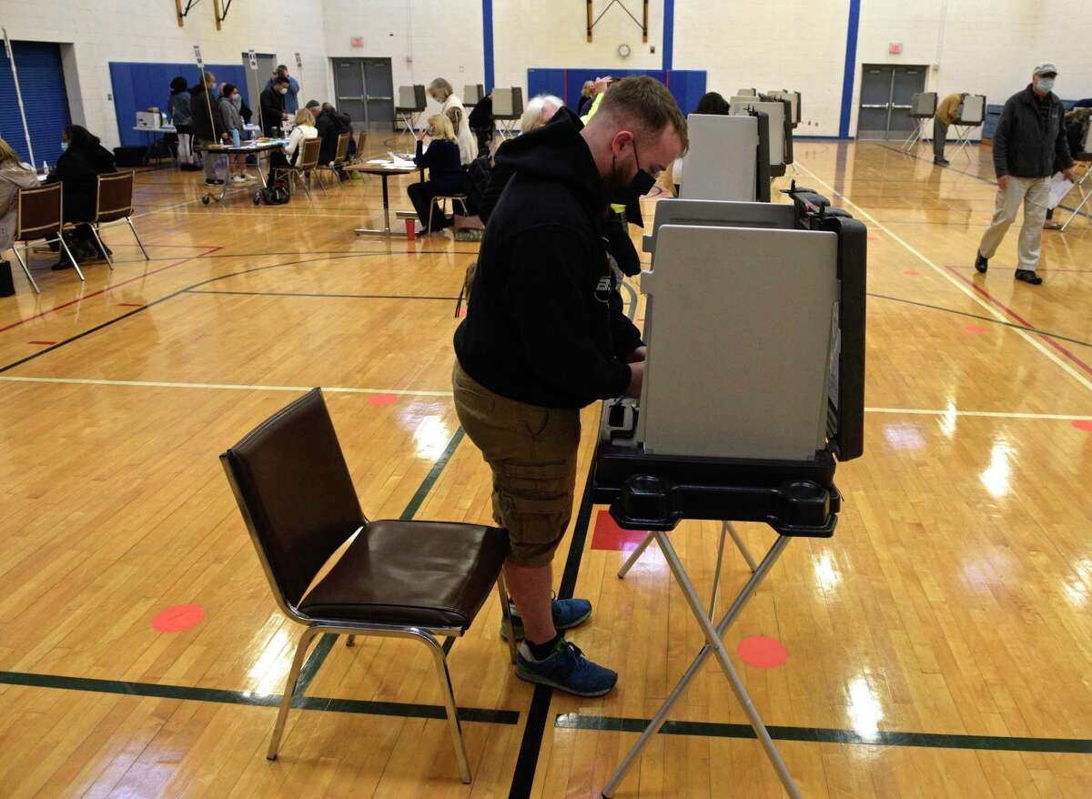 Brandon Kennedy, of Danbury, gets ready to vote for his first time at the Danbury High School polling location, Election Day, Tuesday. November 3, 2020, in Danbury, Conn.