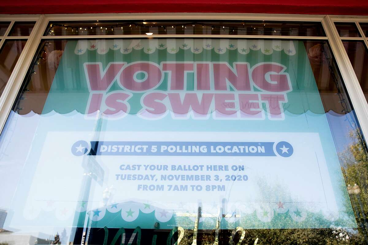 A sign alerts residents to a polling place set up inside Miette Patisserie along Octavia Boulevard in San Francisco, Calif. Tuesday, November 3, 2020. Bay Area residents headed to the polls on Election Day to cast their vote in local and national elections. Polling places are expecting less in-person voter this year due to the increase in mail-in and drop-off ballots.