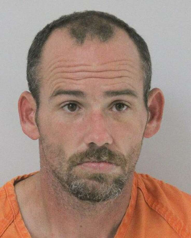 Mark Joseph Mathison, 38, of Onalaska, is being charged with 13 felonies after allegedly holding four people hostage Nov 2 at a New Waverly home. Photo: Courtesy Of The Walker County Sheriff's Office