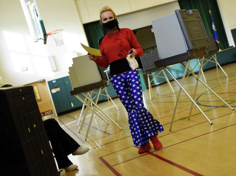 Glenville's Roberta Bosanko-Cera votes on Election Day 2020 at the District 10 polling center at Glenville School in the Glenville section of Greenwich, Conn. Tuesday, Nov. 3, 2020. Connecticut residents cast their votes Tuesday in the Presidential Election between incumbent Republican Donald Trump and Democratic challenger Joe Biden, as well three U.S. House of Representatives positions, and numerous State Senate and House postions. Photo: Tyler Sizemore / Hearst Connecticut Media