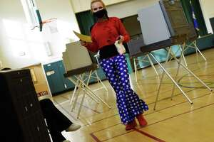 Glenville's Roberta Bosanko-Cera votes on Election Day 2020 at the District 10 polling center at Glenville School in the Glenville section of Greenwich, Conn. Tuesday, Nov. 3, 2020. Connecticut residents cast their votes Tuesday in the Presidential Election between incumbent Republican Donald Trump and Democratic challenger Joe Biden, as well three U.S. House of Representatives positions, and numerous State Senate and House postions.